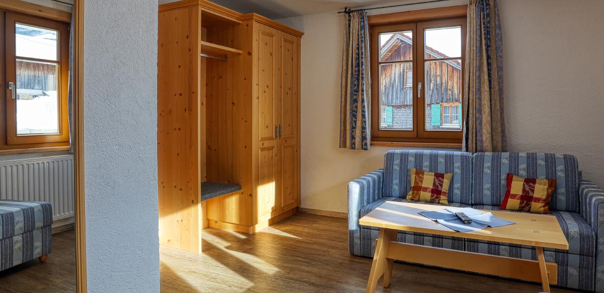 Familienzimmer Komfort ohne Balkon - Wohnbereich | Berggasthof Sonne in Sonthofen